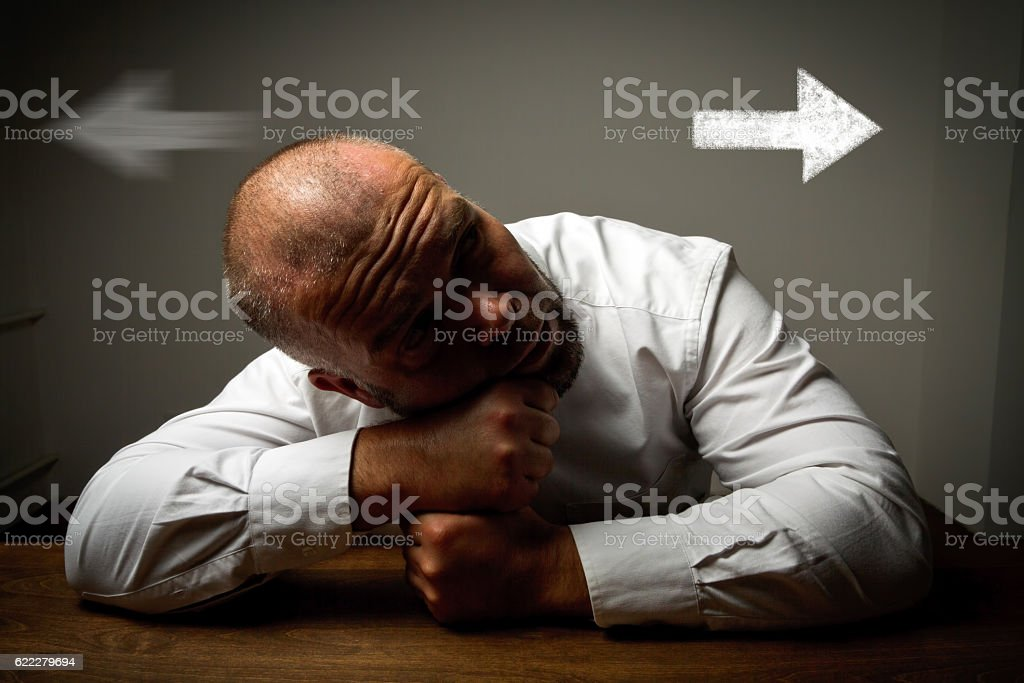 Man in white and two arrows. stock photo