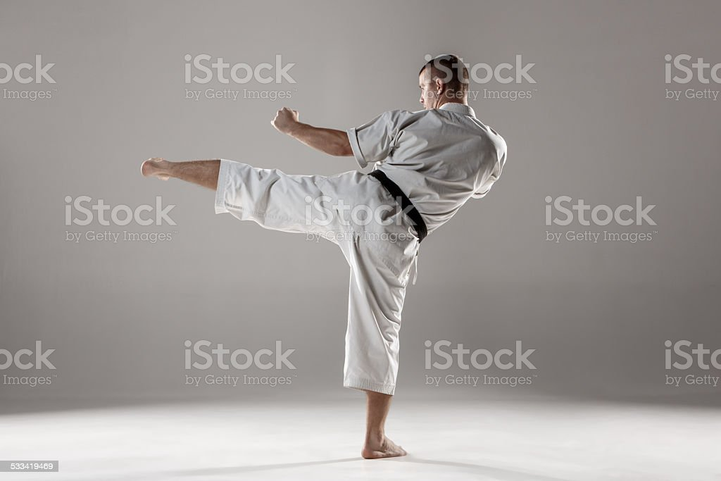Man in white kimono training karate stock photo