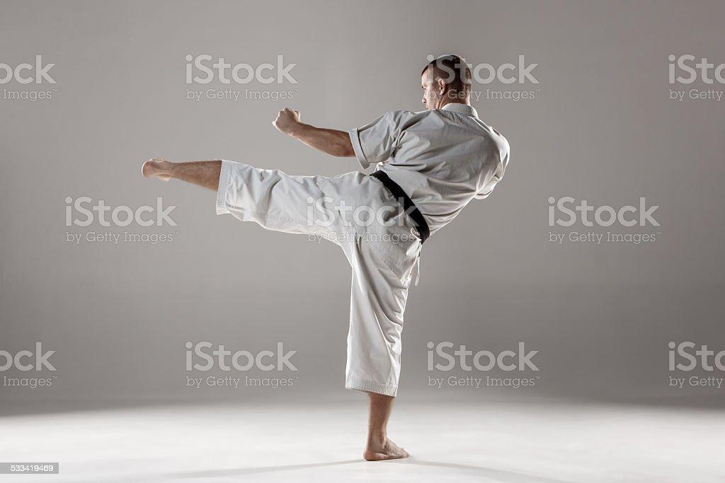 Man in white kimono training karate stock photo