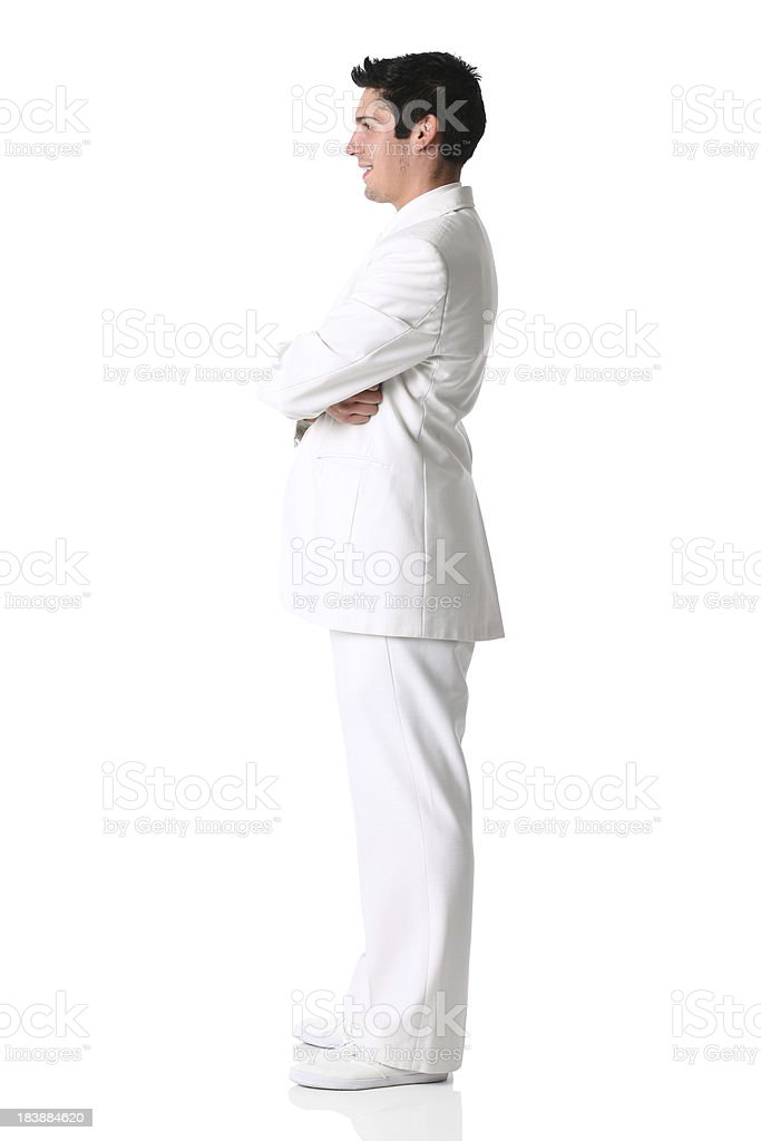 Man in white suit side view stock photo