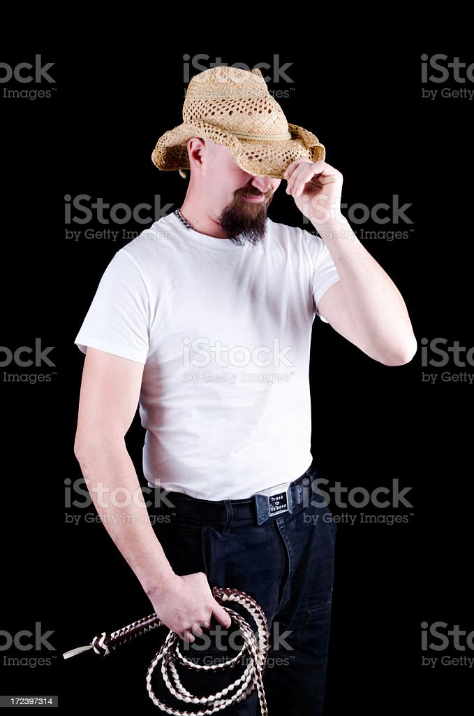Man in white t-shirt and cowboy hat with whip. royalty-free stock photo