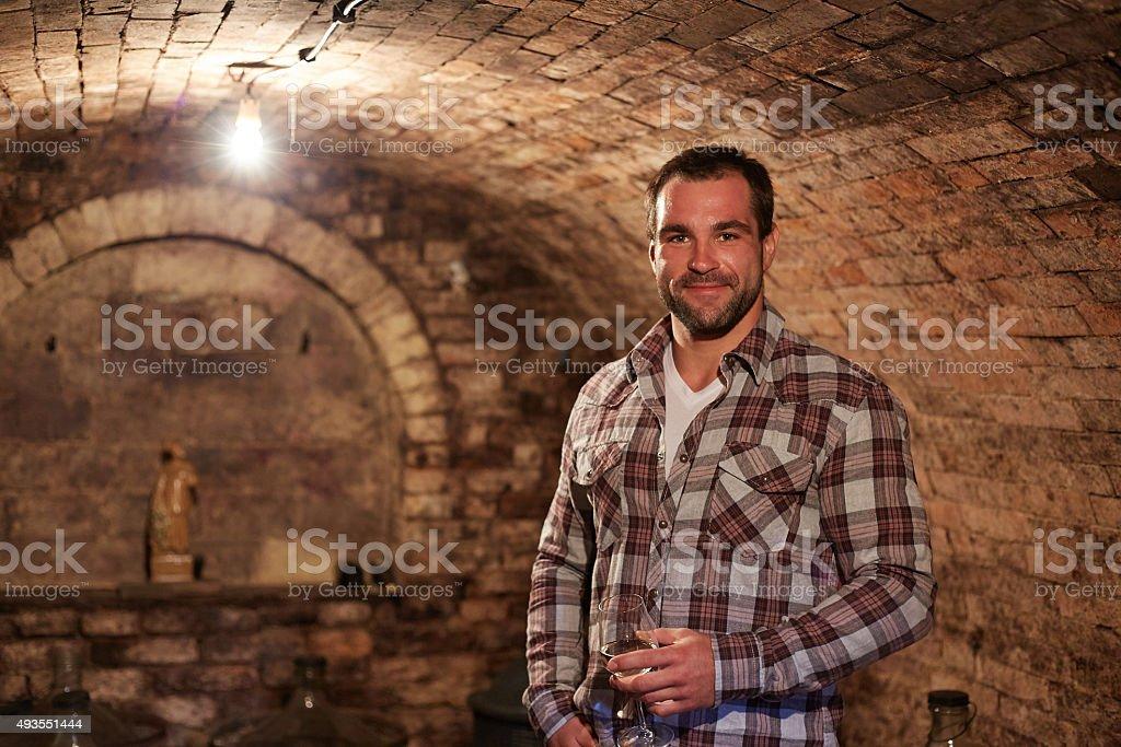 Man in wine cellar stock photo