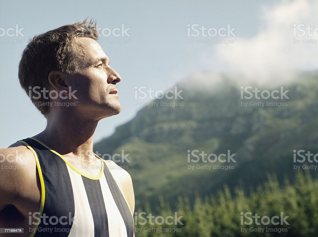 A man in work out gear looking out into the distance royalty-free stock photo