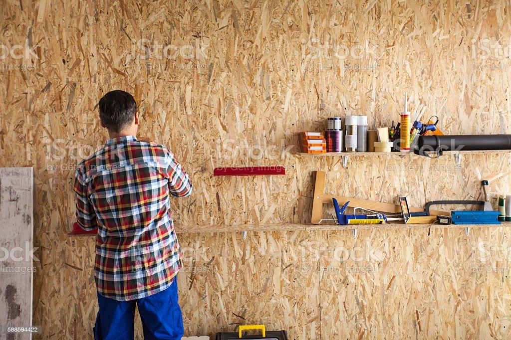 Man in workshop stock photo