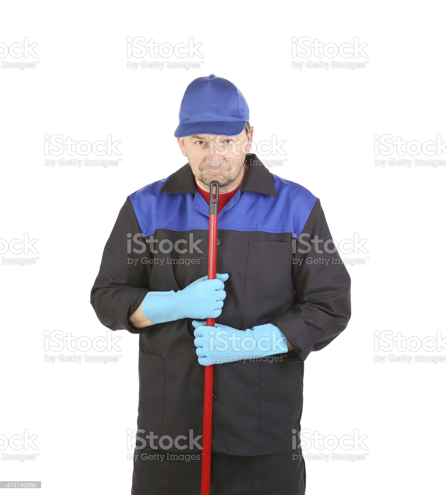 Man in workwear with mop royalty-free stock photo