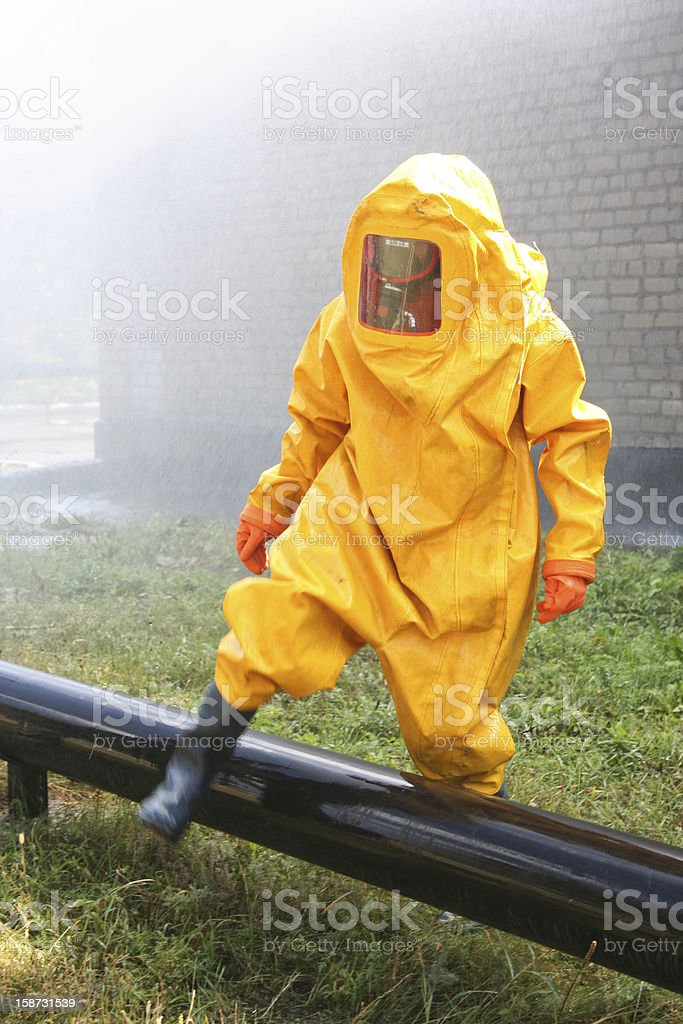 man in yellow chemical suit stock photo
