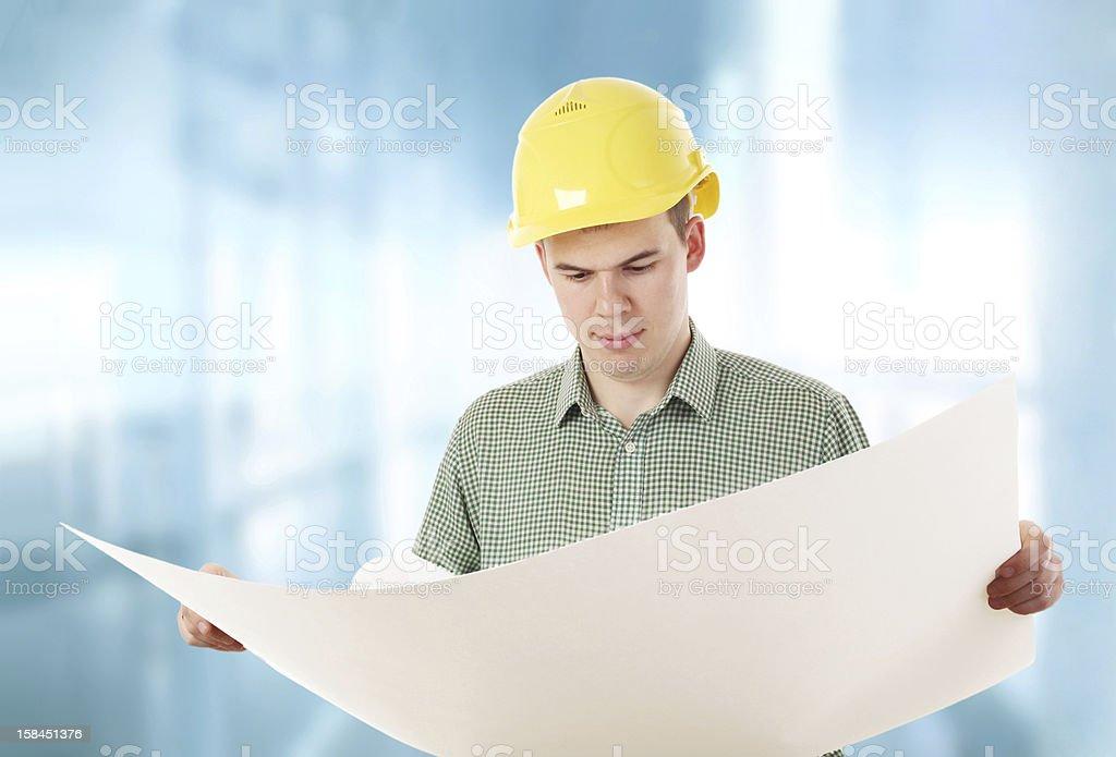 man in yellow hardhat stock photo