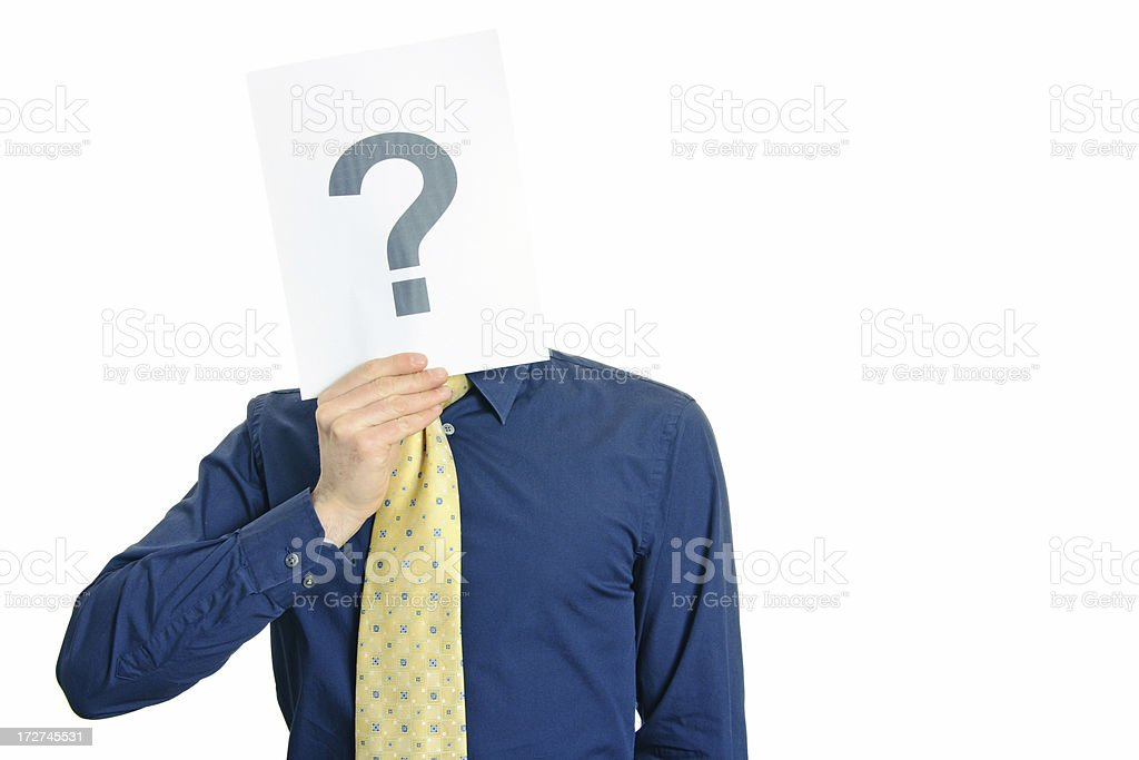 Man in yellow tie holding card with question mark over face royalty-free stock photo
