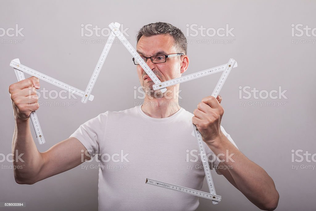 Man inable to fold ruler stock photo