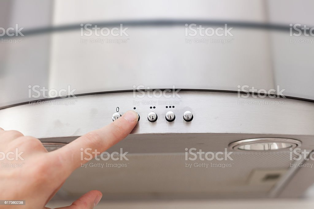 Man includes a stainless steel hood stock photo