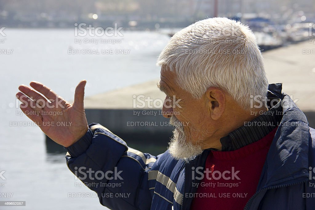 Man indicate the sea royalty-free stock photo