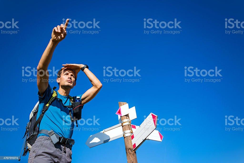 Man indicating direction at the crossroad stock photo