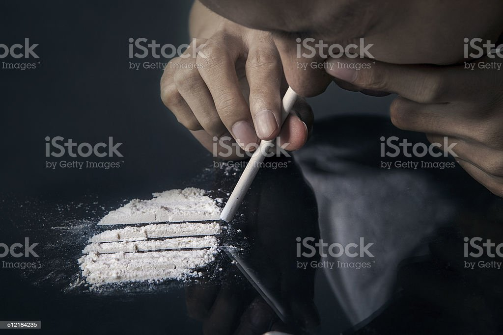 Man inhale cocaine stock photo