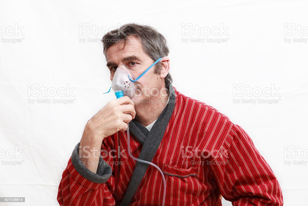 man inhaling medecine stock photo