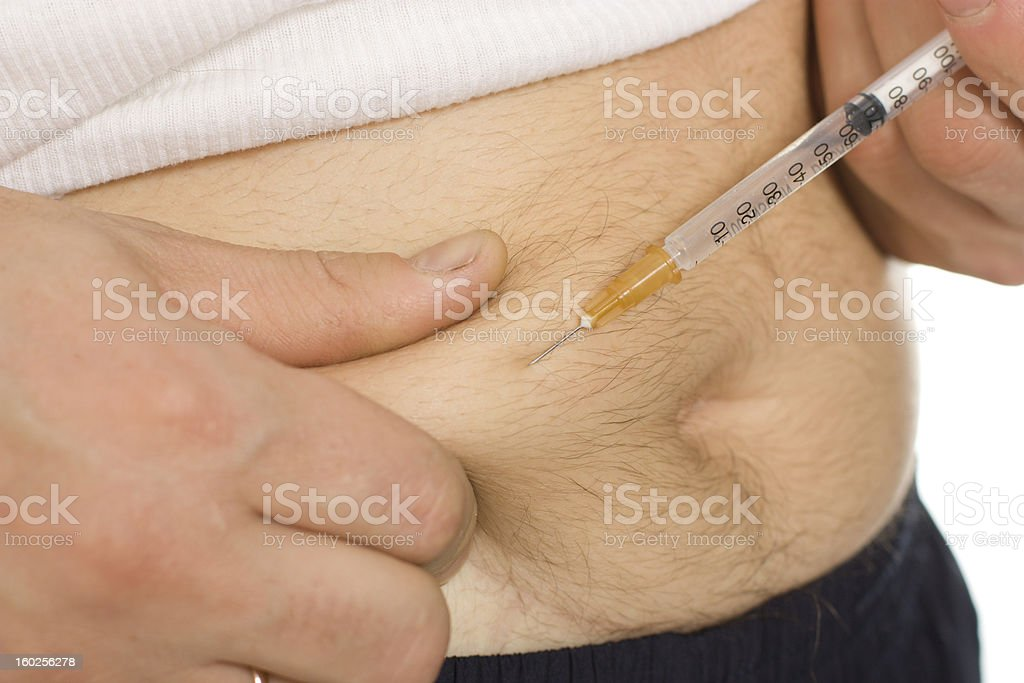 Man inject in the stomach stock photo