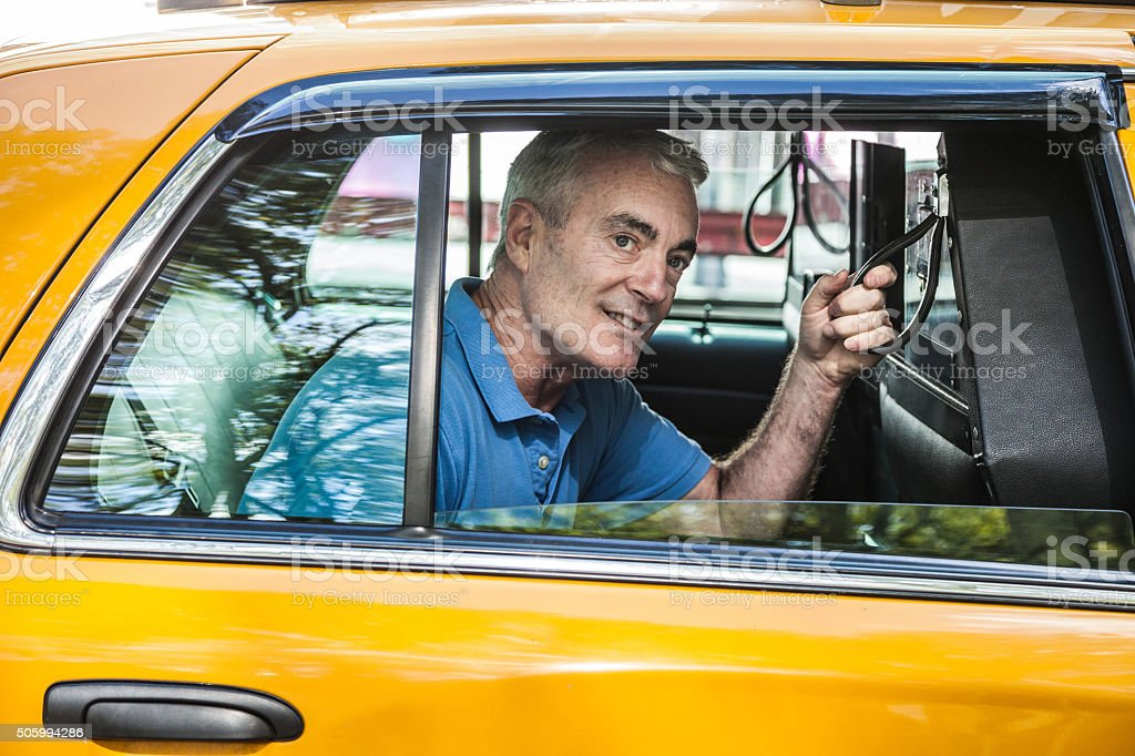 Man inside a taxi in New York downtown stock photo