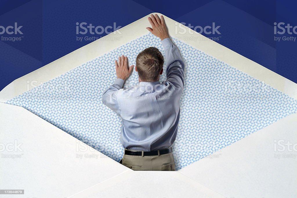 Man inside an Envelope Pushing it Open royalty-free stock photo