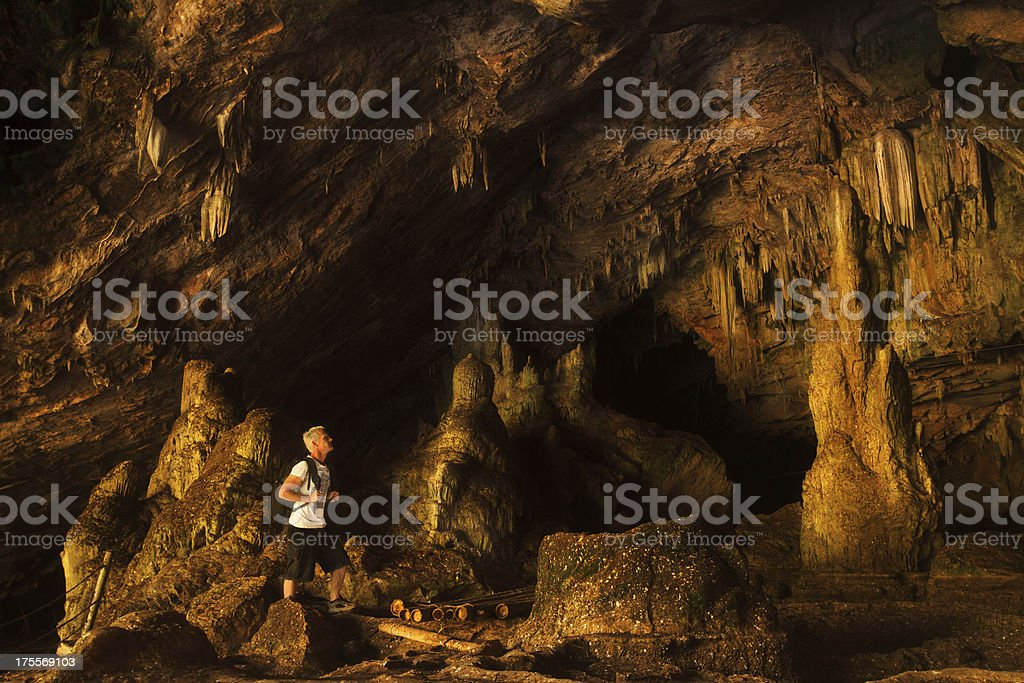 Man inside cave in Thailand royalty-free stock photo