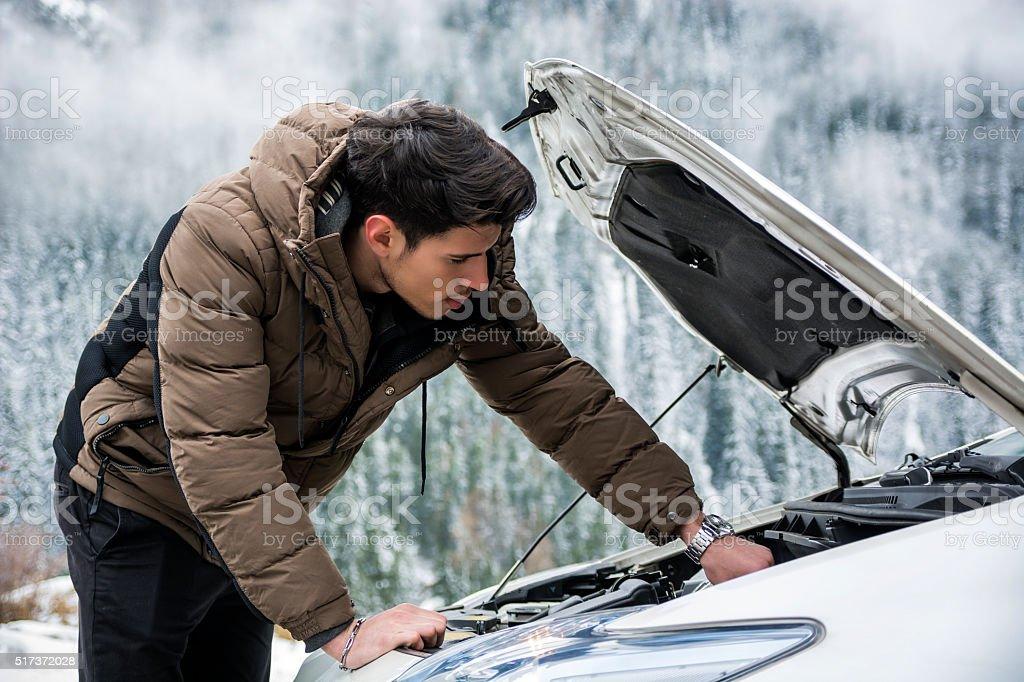 Man inspecting car engine stock photo