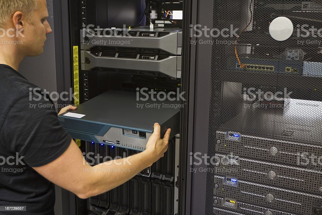 A man installing a network router royalty-free stock photo