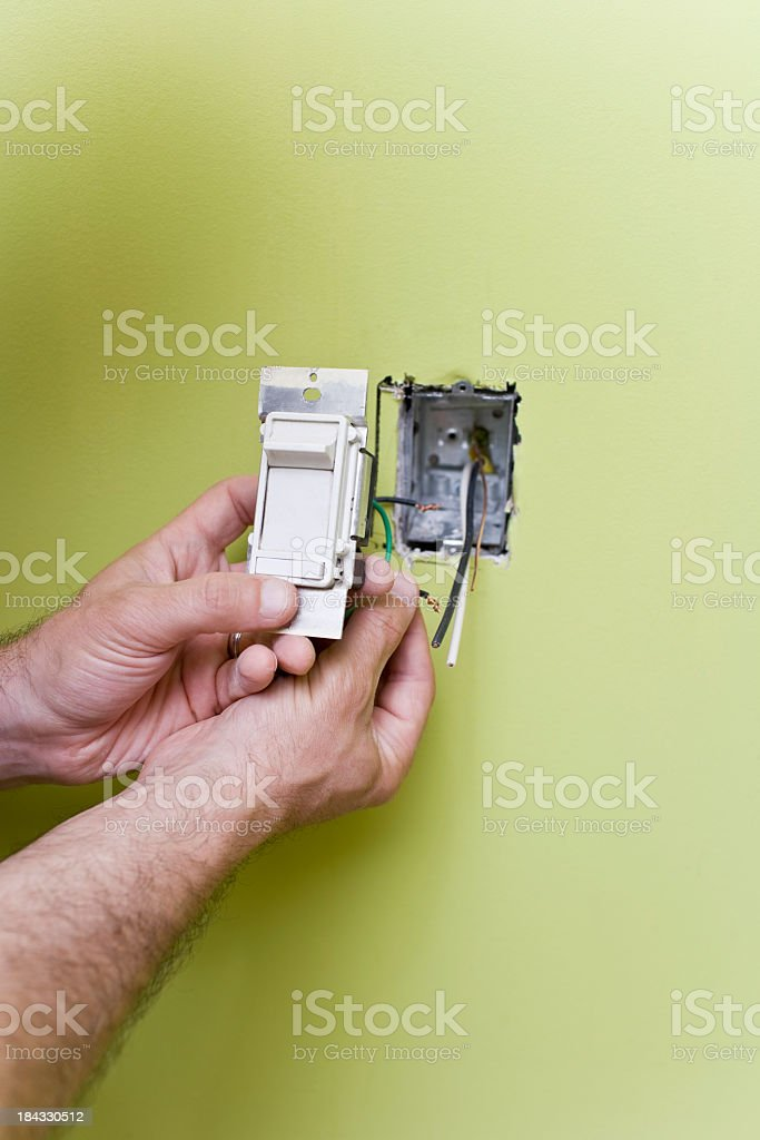 Man installing a new Light Switch stock photo