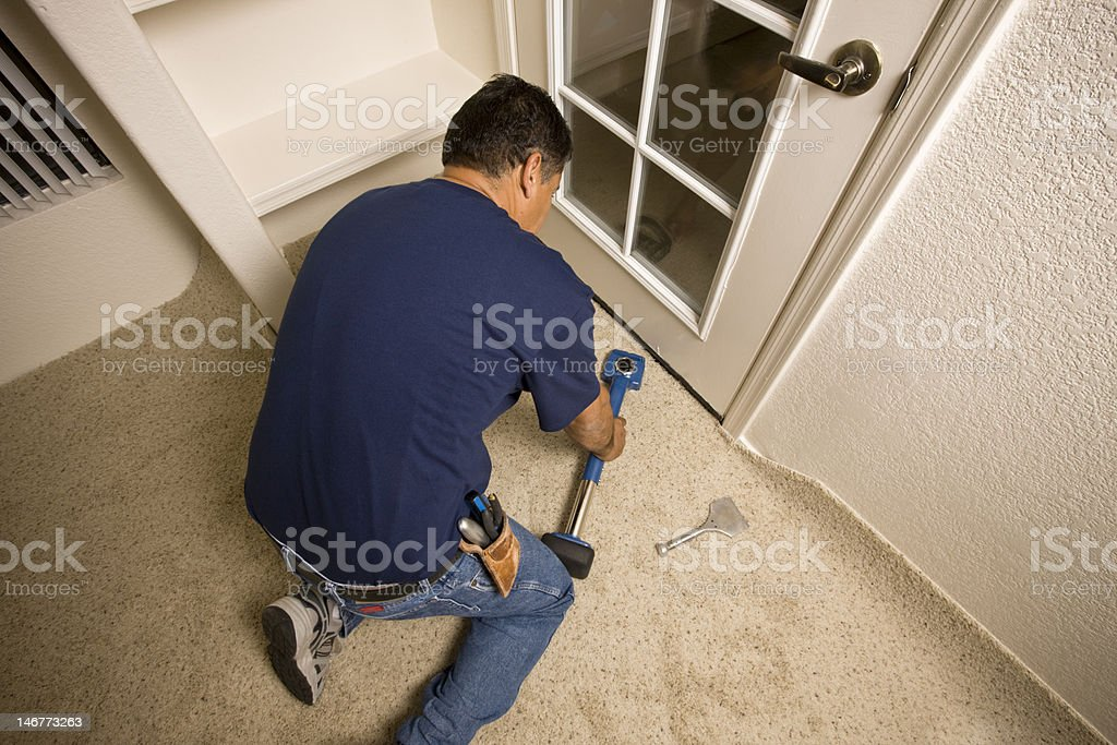 Man Installing Carpet stock photo