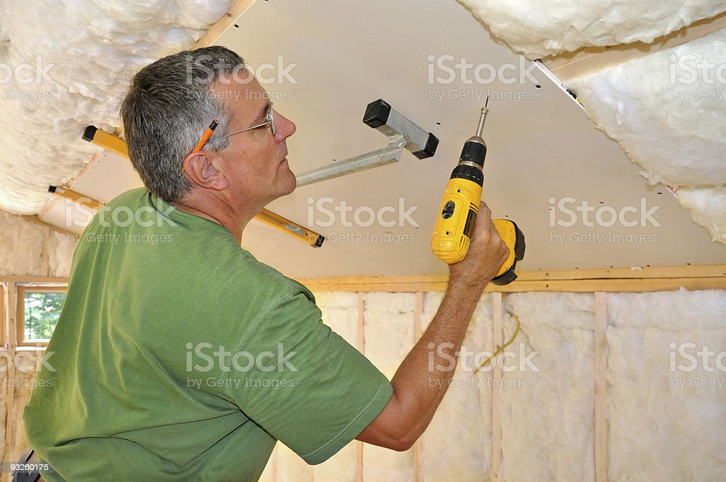 Man installing drywall on ceiling royalty-free stock photo