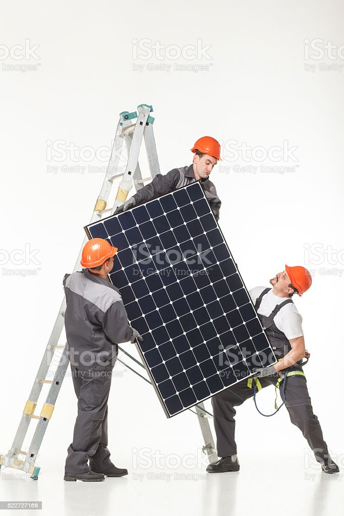 Man installing solar panels stock photo