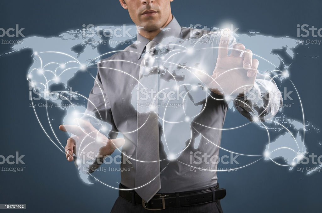 A man interacting with the worlds internet royalty-free stock photo