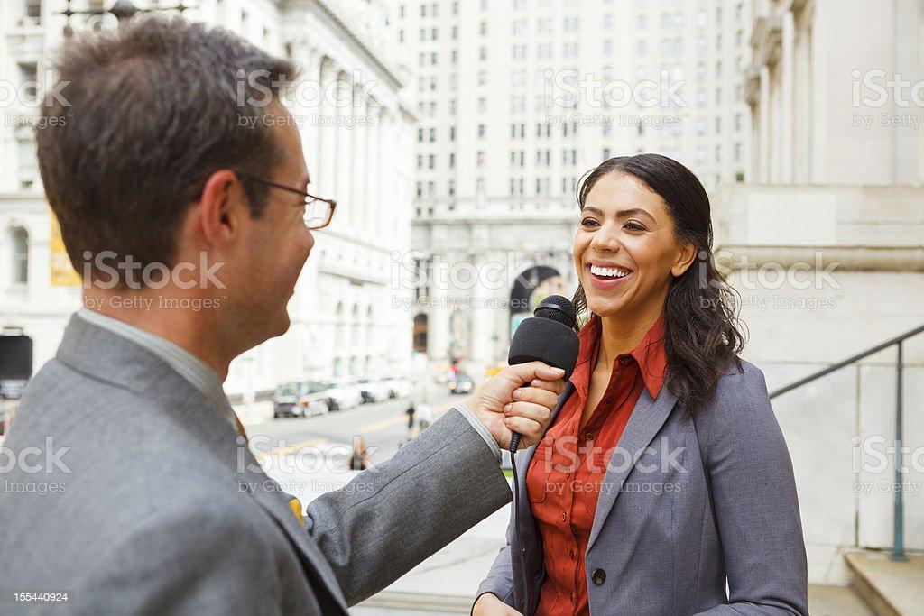 Man Interviews Smiling Woman stock photo