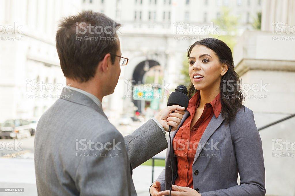 Man Interviews Woman stock photo