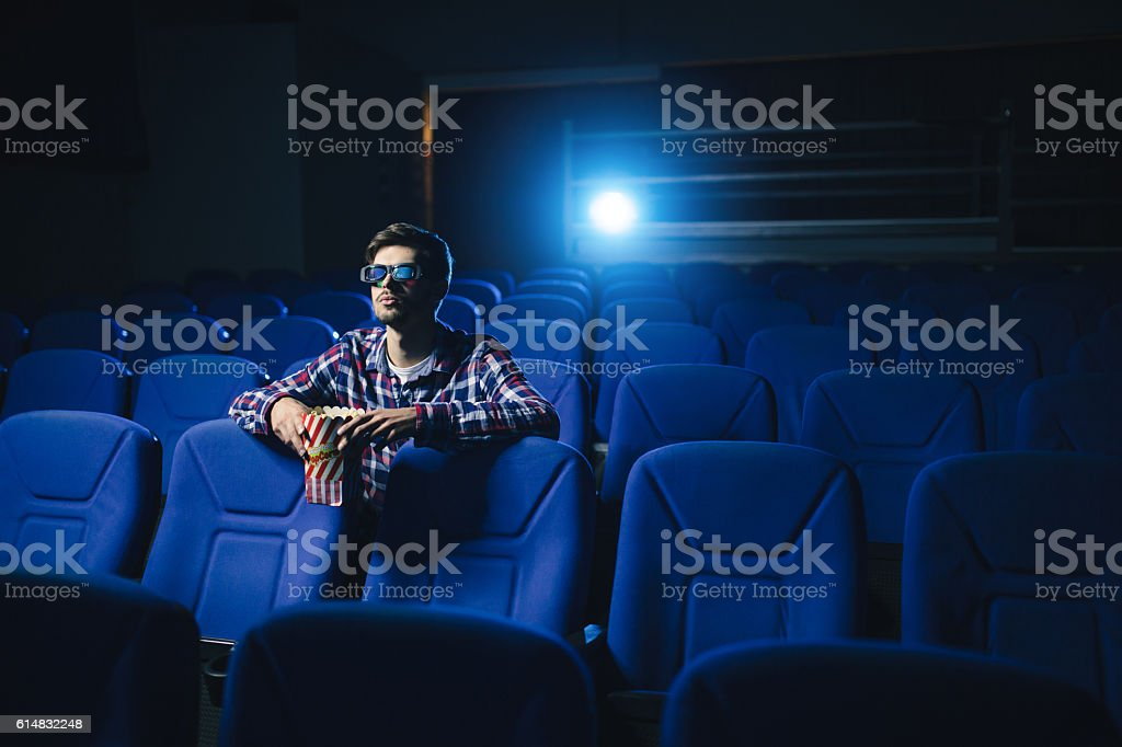 Man is alone in cinema stock photo