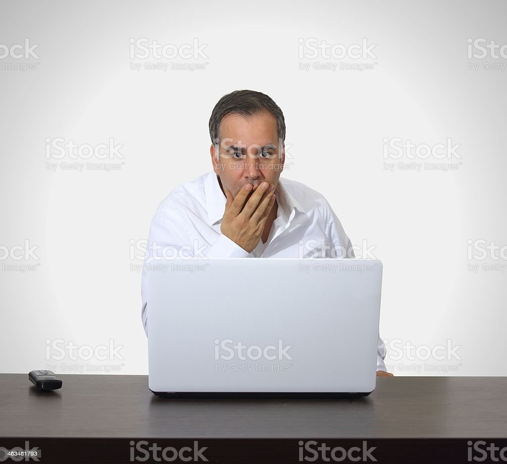 Man is being surprised with computer royalty-free stock photo