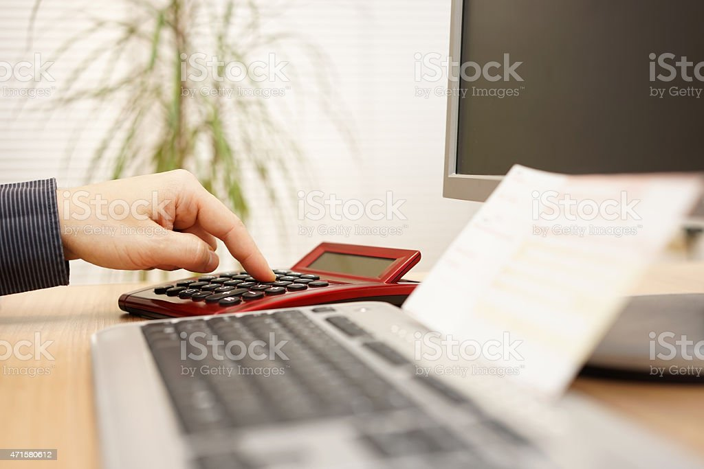 Man is calculating how much money he need to pay stock photo