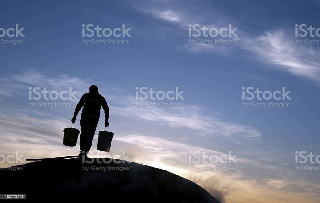 Man is carrying water at rural area royalty-free stock photo