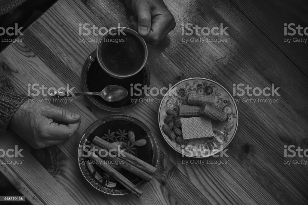 A man is drinking coffee. Still life in the kitchen stock photo