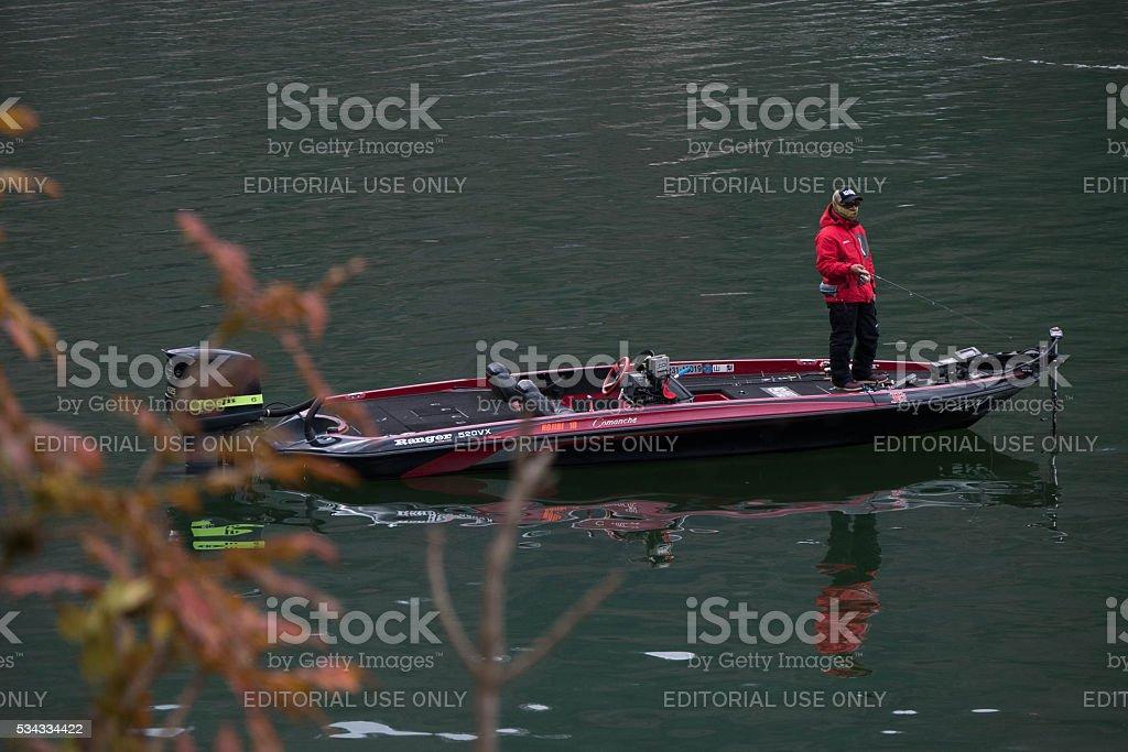 man is fishing at Kawaguchiko lake, Japan stock photo