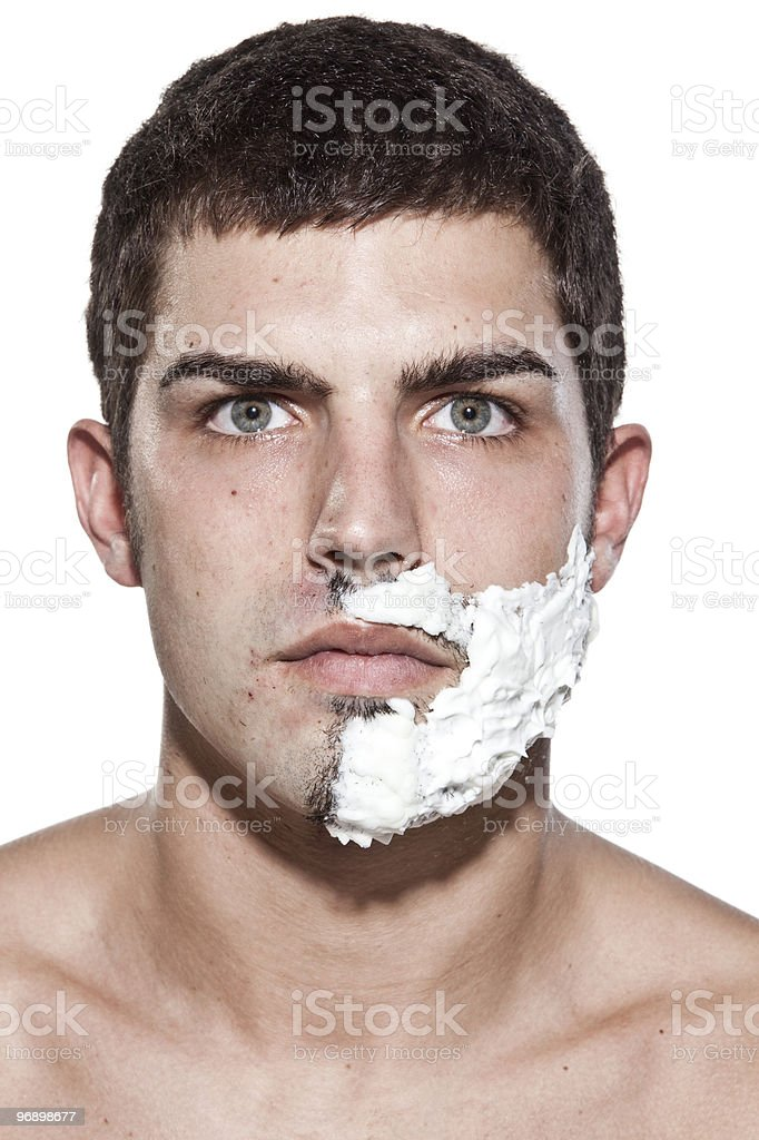 Man is half shaved stock photo