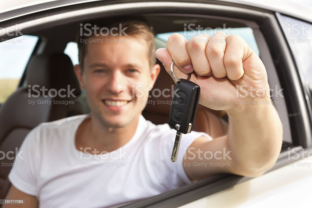 Man is holding his car key sitting inside royalty-free stock photo