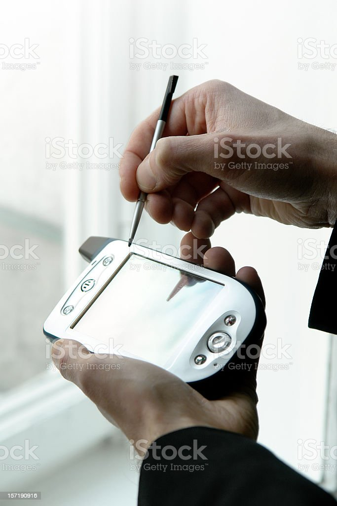 Man is holding in hand mobile phone with scriber stock photo
