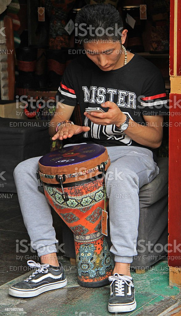 man is playing djembe on the street in Lijiang, China stock photo
