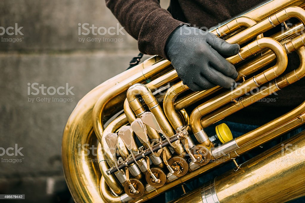 Man is playing on a big tube outdoors. stock photo