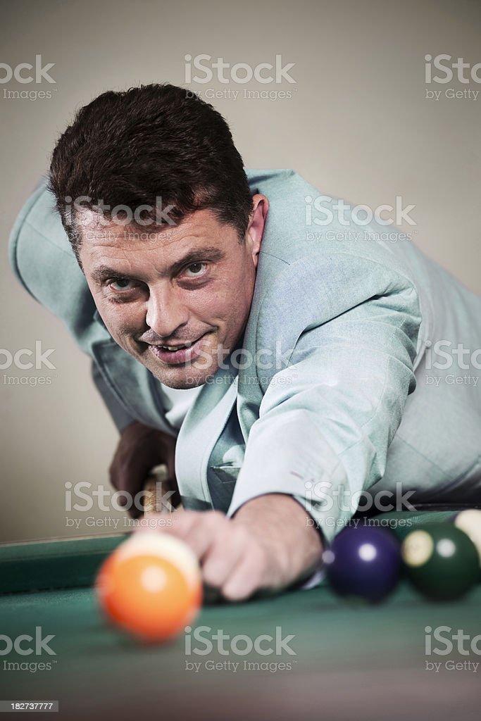 Man is playing pool billiard royalty-free stock photo