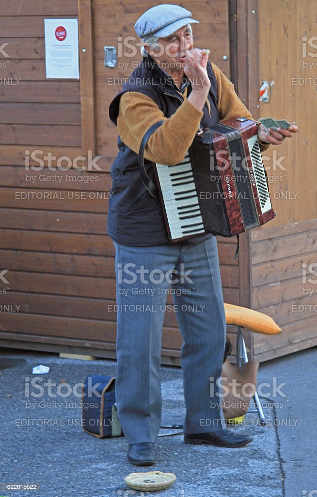 man is playing the accordion outdoor in Vienna, Austria stock photo