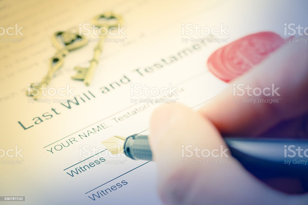 Man is preparing to sign a form stock photo