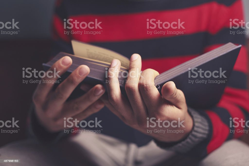 Man is reading a big book stock photo