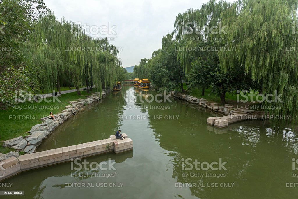 Man is reading a book in the Summer Palace stock photo