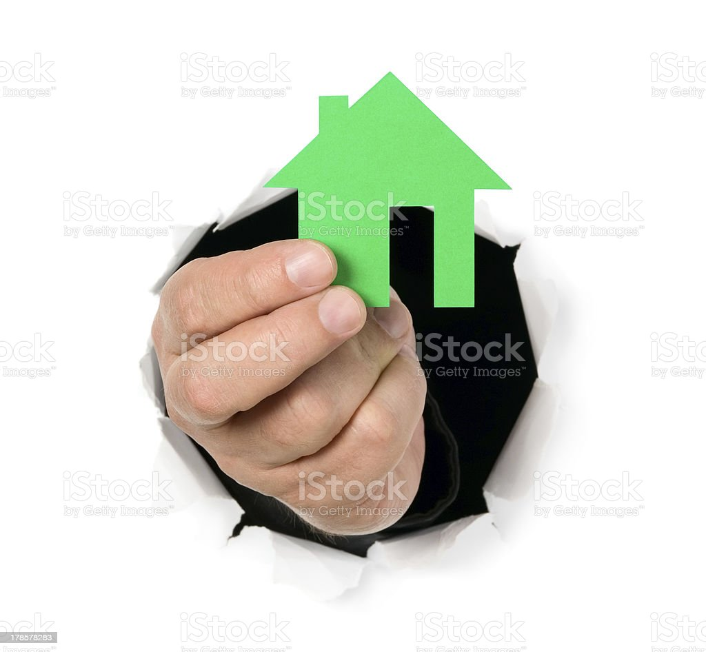 Man is showing house shape through a hole royalty-free stock photo