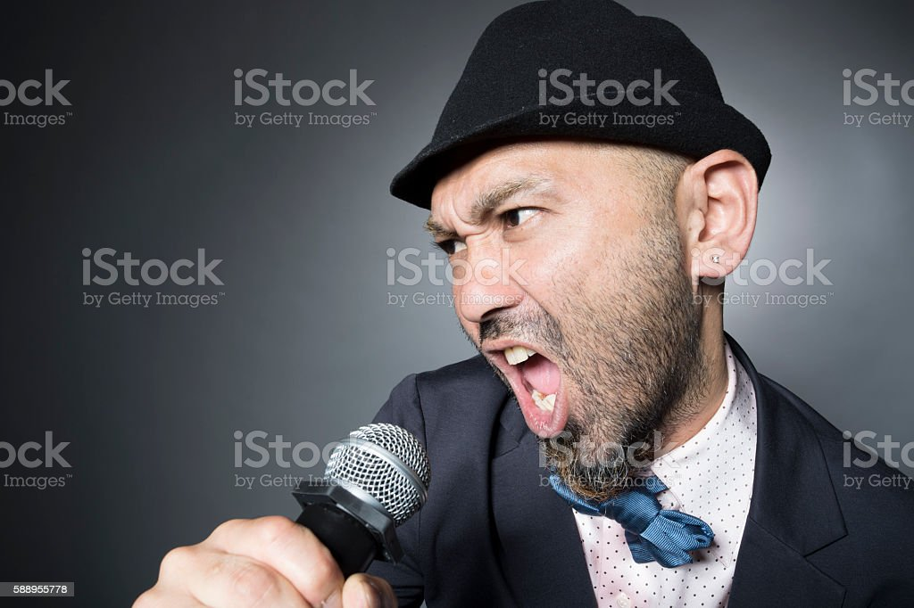 Man is singing a song hard wearing a suit stock photo