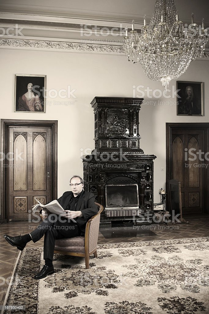 Man is sitting and reading royalty-free stock photo